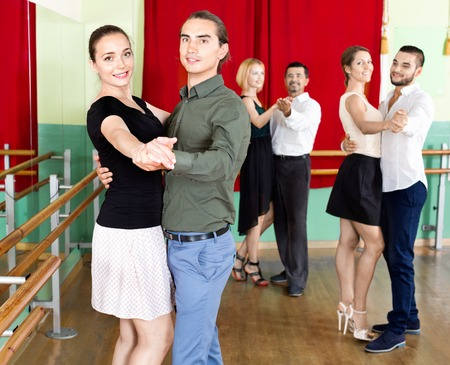 unprofessional: Happy positive adults  enjoying of classical dance in class Stock Photo