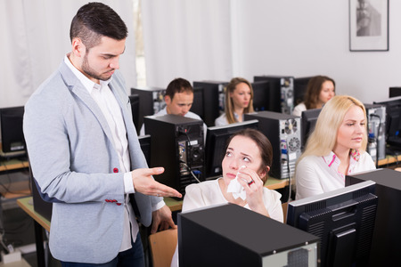 strict: Strict boss and crying european clerk at open space working area Stock Photo