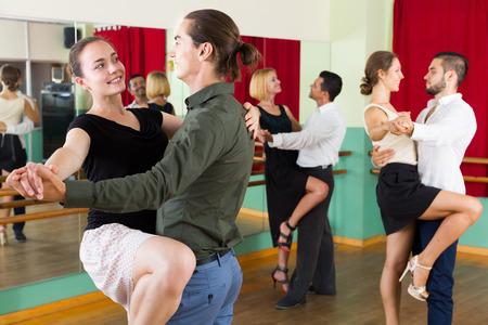 unprofessional: young spanish men and women enjoying of tango in class Stock Photo