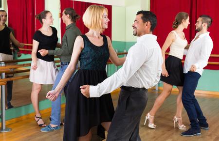 dance steps: Happy men and women enjoying active dance Stock Photo