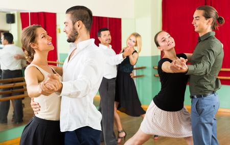 young  people having dancing class in studio Фото со стока