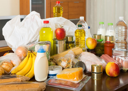 foodstuffs: Still life with foodstuffs on  table in home Stock Photo