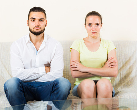 strife: Worried young man and woman talking stressfully
