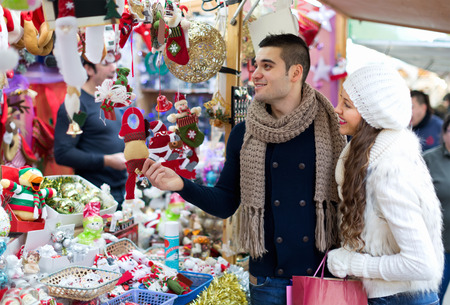 fair: Positive married couple at Christmas market.