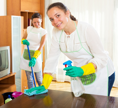 company premises: Beautiful women workers cleaning company ready to start work