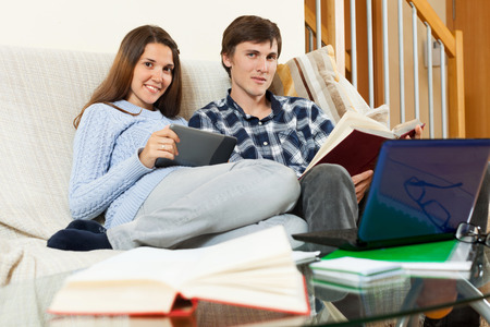 educational materials: Student couple reading a book and educational materials before the exam
