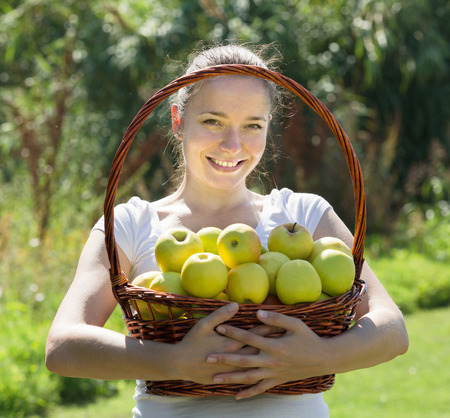 spanish girl: young spanish girl with apples harvest in garden