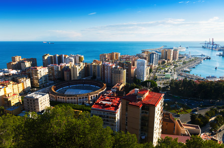 sea port: View of Malaga with Port and Placa de Torros from castle in sunny time.  Andalusia, Spain