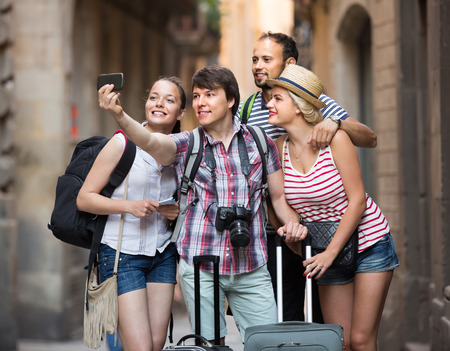 sightseeing tour: Cheerful travelers doing selfie in the sightseeing tour. Selective focus