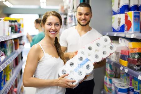 people buying: Happy people buying bath tissue in the shopping mallin the shopping mall