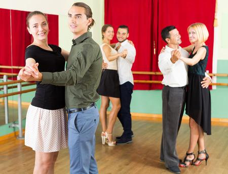 unprofessional: positive european men and women having dancing class in studio