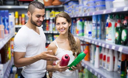 european people: happy european people buying detergents for house in the shopping mall Stock Photo