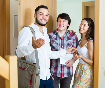 accommodation broker: Realtor showing interior at new flat to merried couple Stock Photo