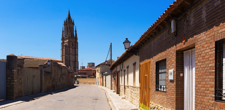 palencia province: Street of Ampudia with bell tower of  Church of San Miguel. Province of Palencia, Castile and Leon, Spain