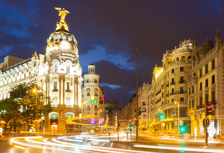 gran via: MADRID, SPAIN - AUGUST 29: City streets in night time on August 29, 2013 in Madrid, Spain.  The Crossing  Calle de Alcala and Gran Via -  most important avenues of city