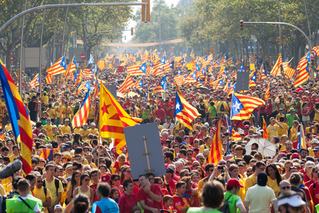 demanding: BARCELONA, SPAIN - SEPTEMBER 11, 2014: People at rally demanding independence for Catalonia (National Day of Catalonia) in Barcelona, Spain