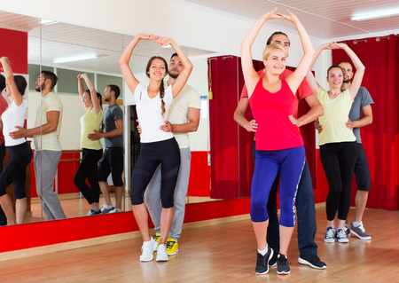latino dance: People dancing bachata  in dance studio