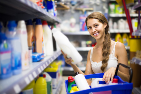vend: european people buying detergents for house in the shopping mall
