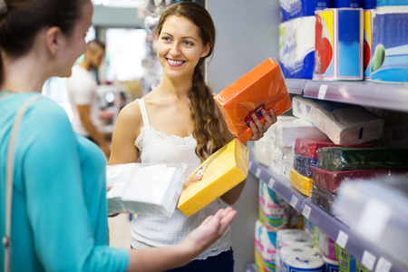 sudarium: Smiling women choose napkins in the shop for party