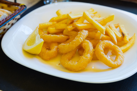 calamares: Calamares a La Romana Fried Squid   on  plate at restaurant table