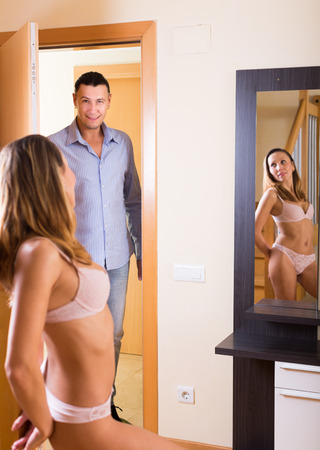 lusty: Young woman in underwear meeting husband from work
