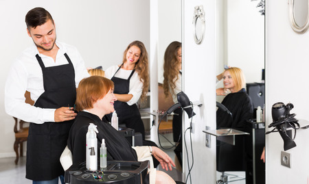 25s: Mature person cuts hair at the hair salon with barber and smiling Stock Photo