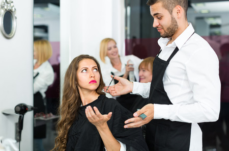 haircutter: Young girl has a serious conversation with the hairdresser