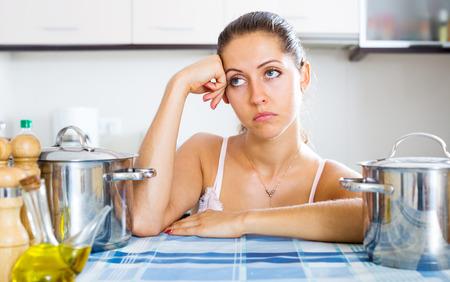 slump: Portrait of sad woman feeling blue indoors