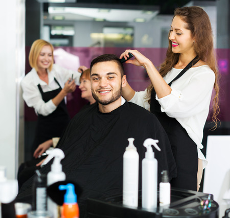 barbershop: Haircutter makes the cut for man in the barbershop