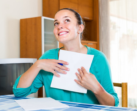 spanish girl: Successful happy spanish girl working with documents at home