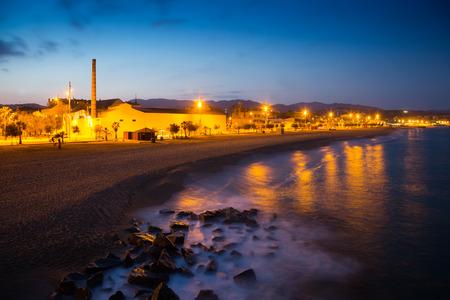 fabrica: beach in evening time.  Badalona, Spain Stock Photo