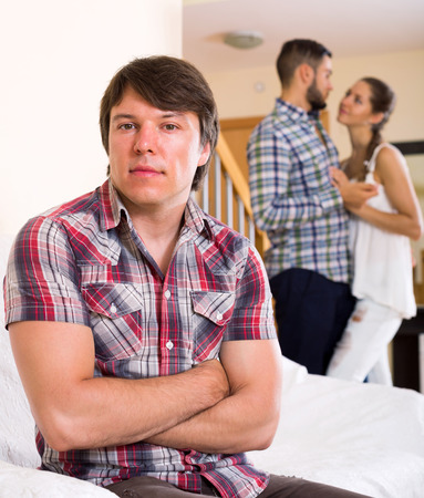 lovers quarrel: Quarrel among young partners at home interior Stock Photo