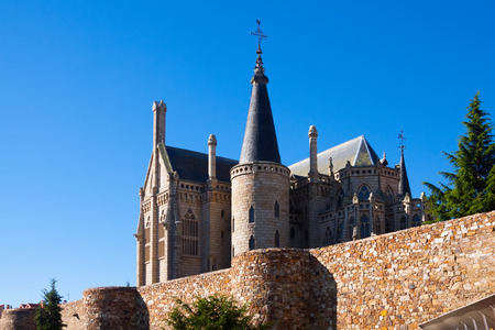 episcopal: Old town walls  and Episcopal Palace of Astorga in summer day.  Castile and Leon, Spain Editorial