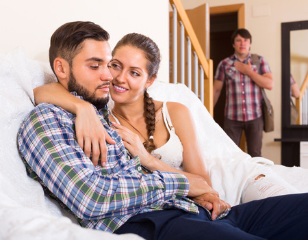 discovering: Young adult discovering his cheating attractive girlfriend at home