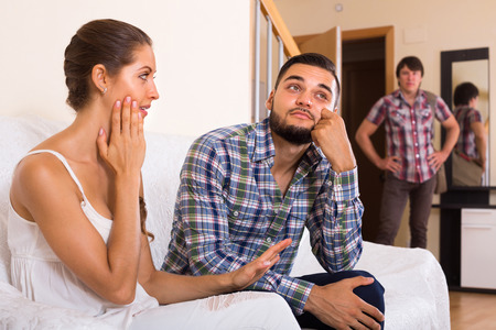 discovering: Upset adult discovering his cheating young attractive girlfriend at home