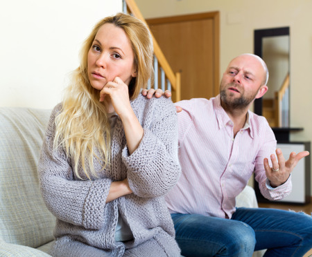 fracas: Man asking for forgiveness from young woman