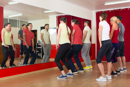 jazz dance: Happy sporty adults dancing at dance class Stock Photo