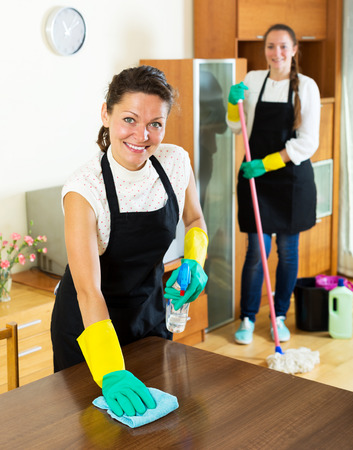 houseman: Smiling young women workers cleaning company ready to start work