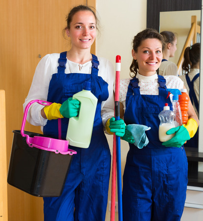 cleaning crew: Professional cleaners crew coming to make cleaning in the house Stock Photo