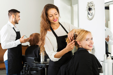 esthetics: Young woman cuts hair at the barbershop