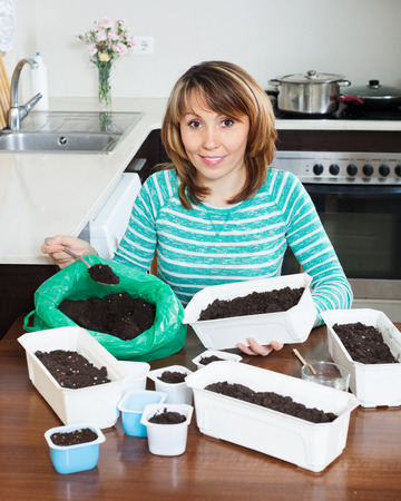 ordinary woman: Ordinary woman making soil for seedling
