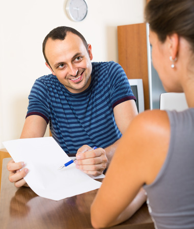 financial planning married: Insurance adult agent helping client to choose the product indoors