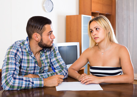 Young man explaining contract terms to girlfriend Stock Photo