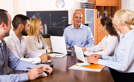Smiling boss makes a presentation at a meeting in the office Stock Photo