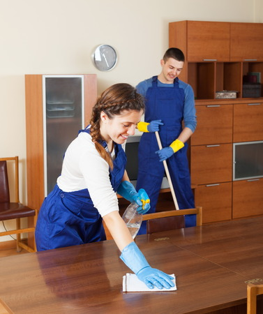company premises: Cleaners team working at living room