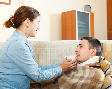 caring for: Wife  caring for sick man at home Stock Photo