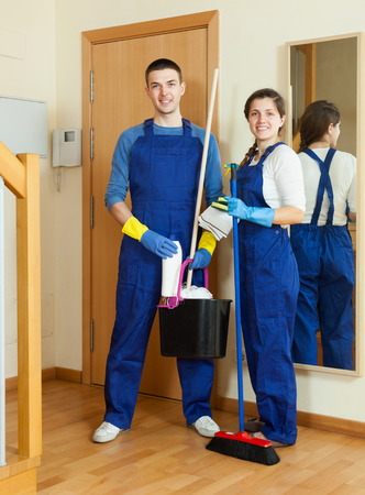 houseman: Smiling cleaners cleaning room at home