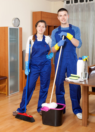 cleaning team: Cleaning team in uniform is ready to work at home Stock Photo