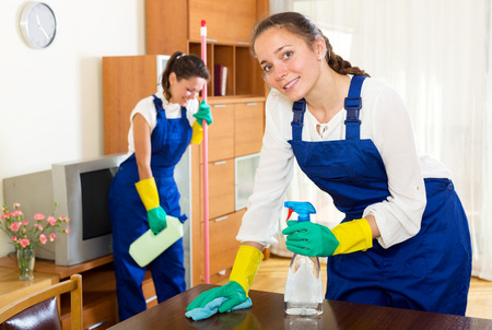 Happy adult female workers cleaning company ready to start work Standard-Bild