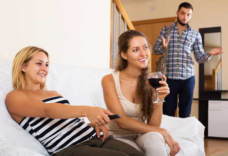 unfaithful: Love triangle: sad husband, smiling wife and lover at home interior